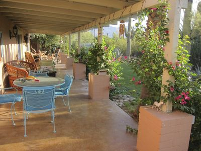 The long porch is great for meals, entertaining/ relaxing and bird/garden action
