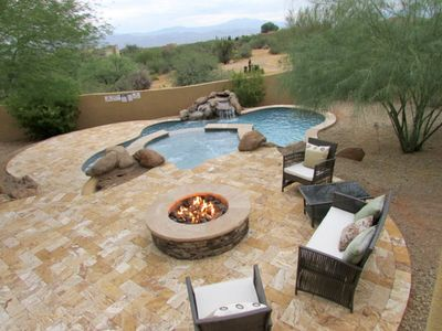 Large fenced in backyard w/ pool/spa heating optional and firepit