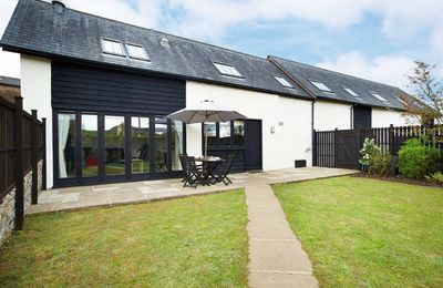 Photo for A delightful property with large open plan kitchen, dining, sitting room and wood burning stove.