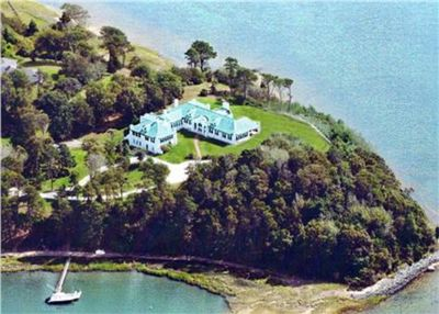 Aerial of the property. A point of land into Pleasant Bay. Water all around.