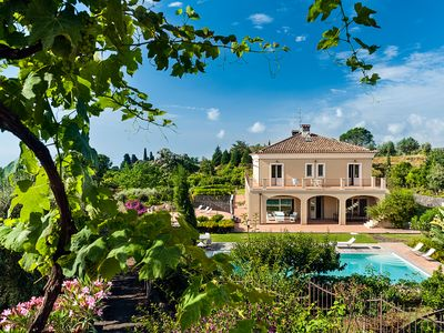 Photo for Elegant villa with pool and garden, high quality furniture inside and outside