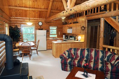 Main floor living room and kitchen with dinning area and wood stove.