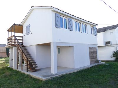 Photo for Typical chalet, 200m from the beach and shops, south facing terrace, WI-FI