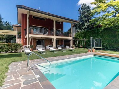 Photo for Villa with swimming pool and magnificent views across green, hilly surroundings