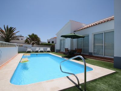 Photo for Luxury Detached Vllla right by the sea, beach and dunes with a large heated pool