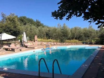 Photo for Beautiful apartment in villa with pool, WIFI, TV, panoramic view, parking, close to San Gimignano