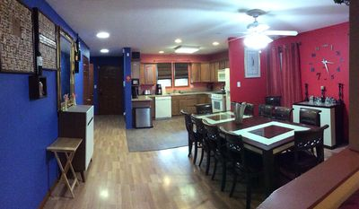 Open kitchen, dining and open kitchen with bar and large dining table.