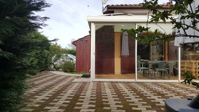 Photo for Air-conditioned pavilion with veranda for 4 people 100 m from the lake.