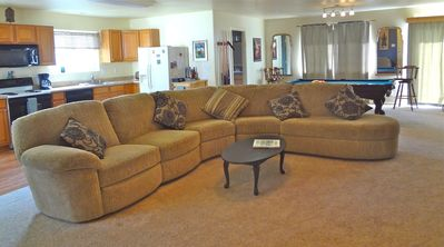 Living room, with Big Comfy Couch that has a recliner.