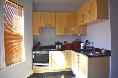 Fully functional kitchen with fitted Smeg oven and hob.