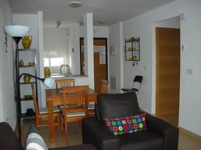 View of dining area, kitchen and hallway