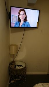 partial view of a private bedroom-smart TV on wall