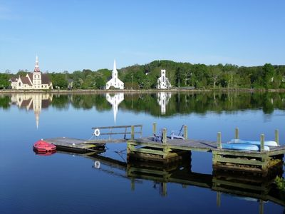 Photo for FAMOUS HARBOR VIEW, PRIVATE WHARF, SUNSETS, BOATS, BIKES, WALK TO TOWN!