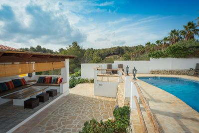 The private pool set in beautiful tropical  gardens with lovely outdoor seating