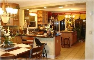 Open Dining Room and Kitchen. Note: Granite counter tops and island for meals