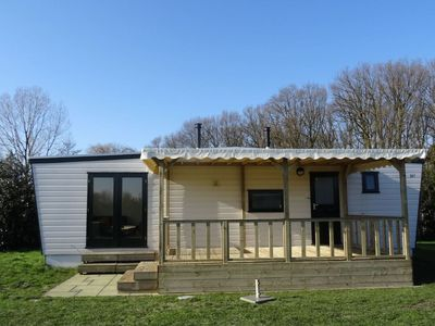 Photo for Neatly furnished chalet, located in a park with a swimming pool