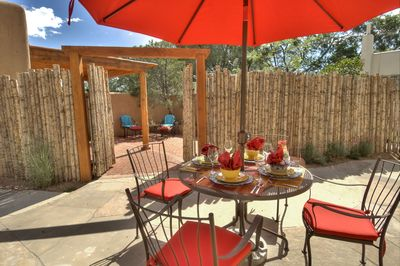 A sunny afternoon garden.  Gates close for separate rental of casita.