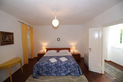 Bedroom 1 overlooks the garden and has a cot.