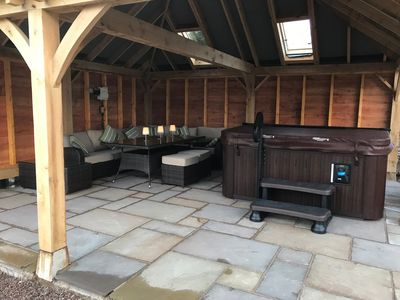 Luxurious covered hot tub to be enjoyed no matter what the weather