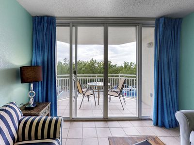 Photo for Sunrise Suites condo w/ balcony! Shared pool, hot tub, tennis, free parking!