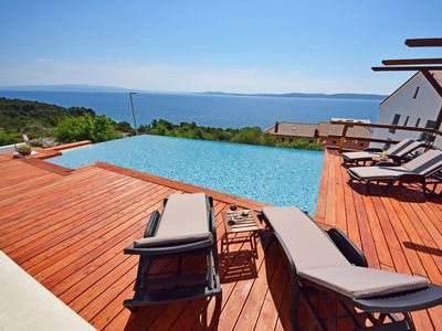Photo for This 3-bedroom villa for up to 6 guests is located in Okrug Gornji and has a private swimming pool,