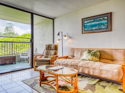 Photo for Fifth floor condo w/ lanai, shared pool, & ocean views - steps from the beach!