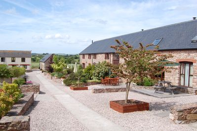 Car free, child friendly courtyard at Newhouse Barton Cottages