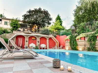 Photo for Elegant Villa with park, huge swimming pool, in the green area of the city cente