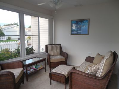Sunny Villa with everything you need including golf cart, Wi-Fi, screened garage