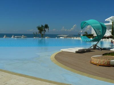 Photo for Fabulous beach front condo with beautiful pool and beach.