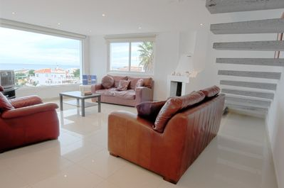 Living area, floating marble  staircase & fab sea views!