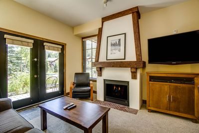 Gas log fireplace starts with the flip of a switch, and brand-new flatscreen TV.