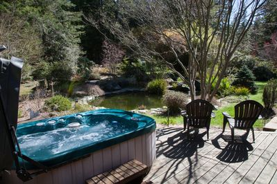 Hot tub overlooking the koi pond. outside master bedroom