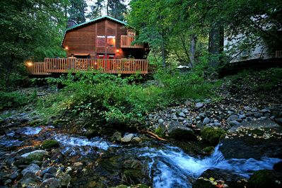Enjoy this cabin tucked away, stream side, at the end of a private lane.
