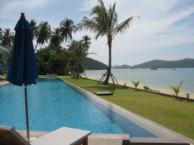 Photo for Stunning beach front Phuket hideaway with unrivalled island views and sunsets