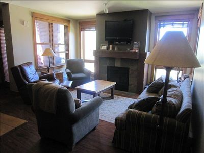 Living Room area with Flat Panel TV and Swivel Rocker Recliner.
