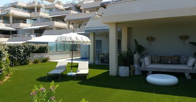 Photo for Large garden floor with direct access to the playground and pool. Beach and restaurant