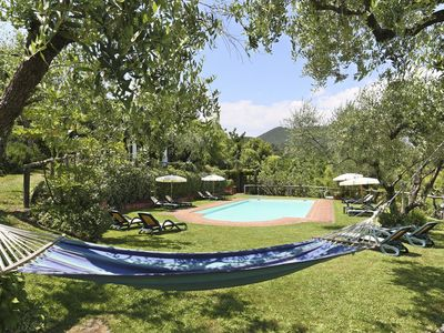 Photo for Cosy apartment for 5 people with pool, TV, pets allowed and parking, close to Lucca