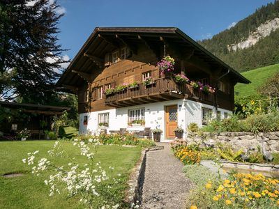 Photo for Gstaad Duplex Flat - Amazing Lake Chalet with pond