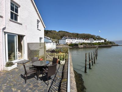 Photo for 2 Bedroom Waters Edge Cottage With Panoramic Sea Views. sleeps up to 4