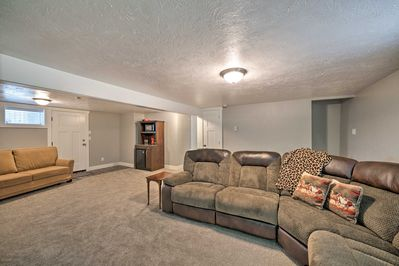 The home features 2 separate living rooms with sectional sofas & flat-screen TVs