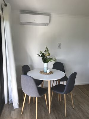 Dining Table with aircon above