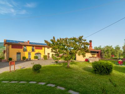Photo for Apartment in country house in olive grove with fenced pool and soccer field