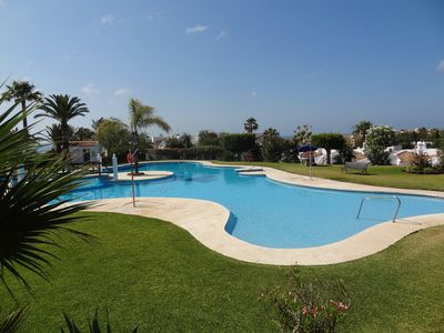 Photo for Stunning Garden Apartment Overlooking the Inviting Communal Pool and Gardens