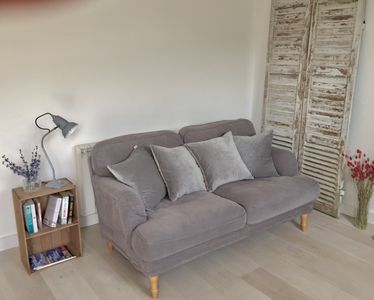 The comfy sofa and plump cushions are perfect for curling up and relaxing