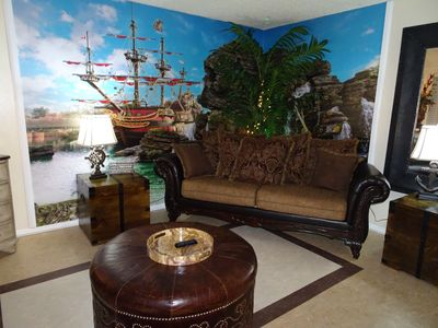 Living room with pirate ship mural and treasure chests