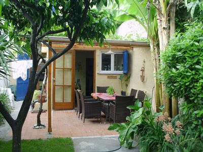 Photo for Old town house with garden and underground parking 3 minutes to the beach