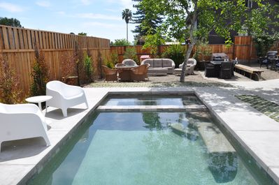 Pool and hot tub in the yard.