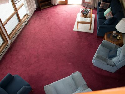 Photo of living room. Living room features a walk out deck.
