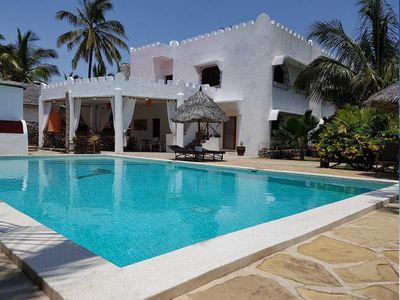 Photo for Immersed in fabulous tropical gardens equipped with swimming pool.